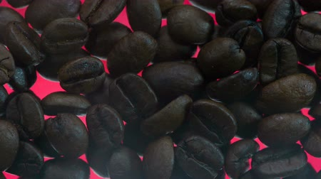 infra : Smoky over Roasted Coffee Beans. Over the coffee beans is a light smoke. Coffee beans are roasted on glowing red surface using infra red radiation Stock Footage