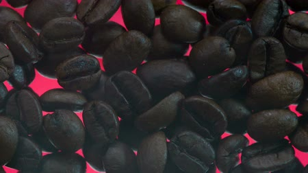 Smoke during Roasting Coffee. Over the coffee beans is a light smoke. Coffee beans are roasted on glowing red surface using infra red radiation