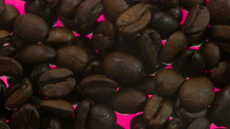 infra : High-Tech Coffee Roasting. Over the coffee beans is a light smoke. Coffee beans are roasted on glowing red surface using infra red radiation Stock Footage