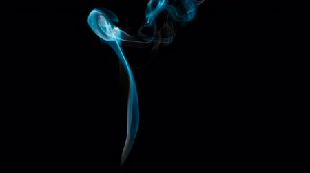 Slow Ornate Smoky Stream. The bright blue Smoke slowly rises upward forming beautiful loops and rings that hang on a black background Stock mozgókép