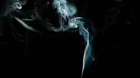 smolder : Magical Blue Smoke Stream. Natural Colorful smoke rises up and spins into graceful spirals. Filmed at a speed of 240fps Stock Footage
