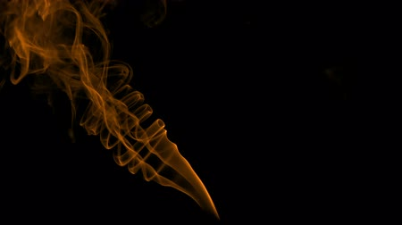 smolder : Fire Evaporation on the Black. Natural Colorful smoke rises up and spins into graceful spirals. Filmed at a speed of 240fps Stock Footage