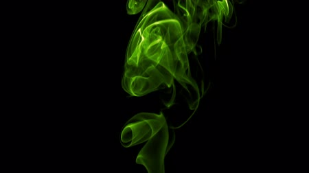 Green Poisonous Vapors. Natural Colorful smoke rises up and spins into graceful spirals. Filmed at a speed of 240fps Stock mozgókép