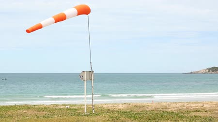 field measurements : A wind force (windsock) against the dark sea and blue sky