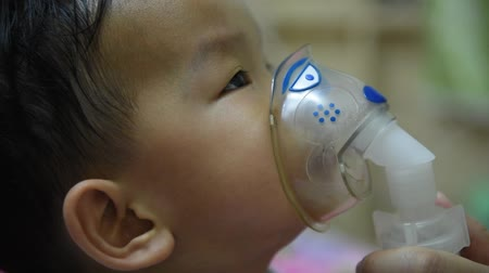 asthma : child in a mask for breathing inhalation medication