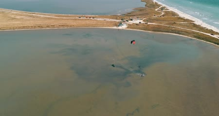 uçurtma : Kitesurfing in the Azov sea. Aerial 4k cinematic kite surfing top view Stok Video
