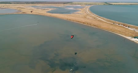 yassı : Kitesurfing in the Azov sea. Aerial 4k cinematic kite surfing top view Stok Video
