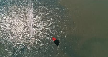 карибский : Kitesurfing in the Azov sea. Aerial 4k cinematic kite surfing top view Стоковые видеозаписи