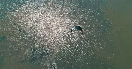 Kitesurfing in the Azov sea. Aerial 4k cinematic kite surfing top view Stock Footage