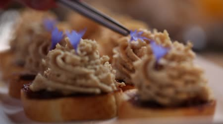 pasztet : Chef garnishes pate with edible purple petals