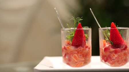 rokfor : Fresh salad with strawberry and salmon in glass. Camera moves from side.