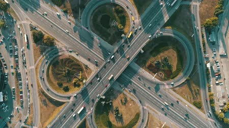 Motor vehicle roundabout from above Stock Footage