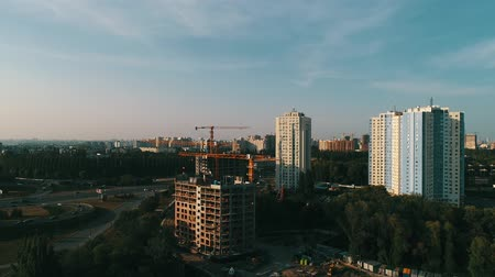 the construction crane and the building against the blue sky Stock Footage