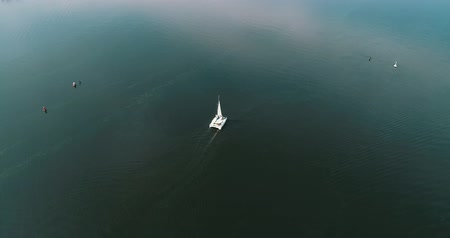 navigasyon : Luxury catamaran in the river Dnepr, Kyiv, Ukraine. Aerial view. Stok Video