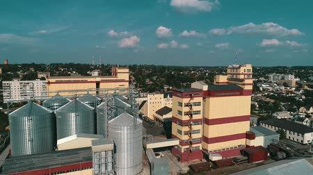 storage tank : Agricultural grain dryer complex. Modern granary with weighing station Stock Footage