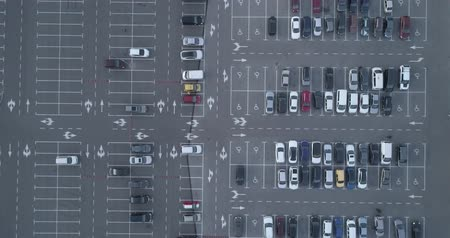 vacant : 4k top aerial view of carpark with lots vacant space places traffic diagram.