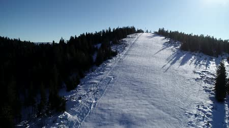 lesiklás : Aerial landscape snow slope with ski elevator in winter ski resort. Winter activity on luxury ski resort drone view Stock mozgókép