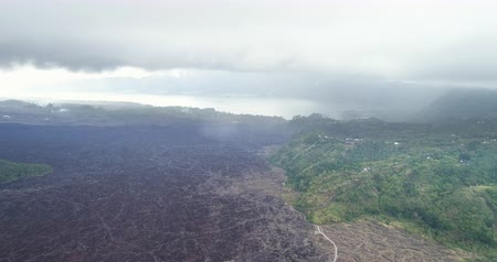 кратер : Flight over of cooled lava field - Aerial view of Batur volcano, Bali Стоковые видеозаписи