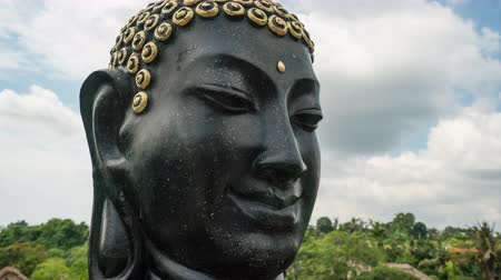 budha : Time lapse shot of Buddha face, Buddha head sculpture.