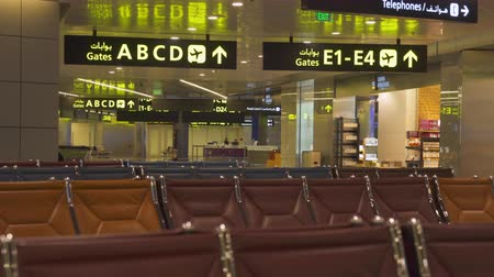 banquinho : Empty chairs, airport terminal waiting area - October 2017: Doha, Hamad International airport, Qatar Vídeos