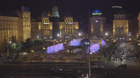 escala : Maidan square with fountains in Kiev at night. Crowd of people on the street - June 2017: Kiev, Ukraine