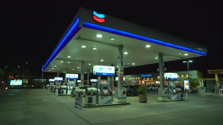 pompki : Chevron, American gas station at night - August 2017: Los Angeles California, US