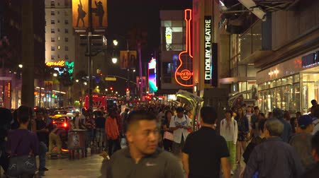fame : Crowd of people in Hollywood blvd. at night. Walk of fame - August 2017: Los Angeles California, US Stock Footage