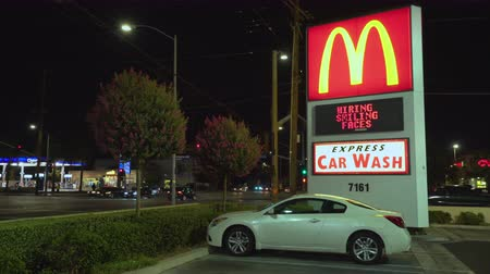 mc : Mc Donalds sign at night. Mc Donalds logo - August 2017: Los Angeles California, US Stock Footage