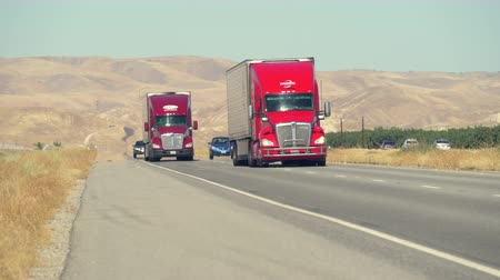 trucks : Traffic on the freeway. Trucks on the highway, California interstate - August 2017: Highway 5, California, US