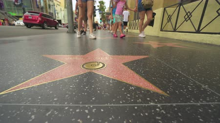 körút : Famous Walk of Fame stars. Slider shot - Hollywood Blvd - August 2017: Los Angeles California, US Stock mozgókép