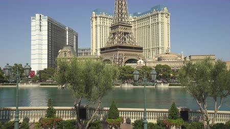 körút : Bellagio music fountain and Paris casino. Las Vegas cityscape - August 2017: Las Vegas, Nevada, US Stock mozgókép