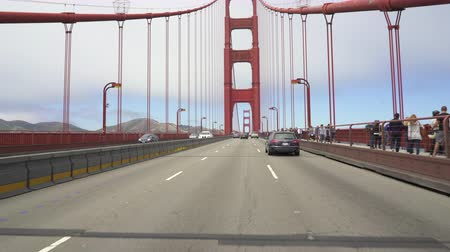 drive through : Point of view shot of Golden Gate Bridge - August 2017: San Francisco, California, US