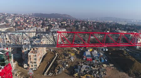 construction work : Aerial view of crane in the construction site. Aerial shot of tower crane - March 2018: Budapest, Sasad, Hungary