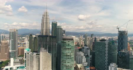 twin : Aerial view of Kuala Lumpur downtown. Skylines and Petronas tower - October 2017. Kuala Lumpur, Malaysia Stock Footage