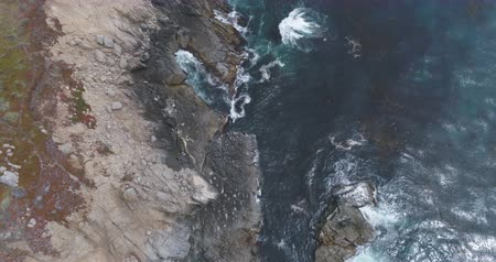 íngreme : Flight over of rocky coastline. Aerial of Ocean shore, waves crashing cliffs Stock Footage