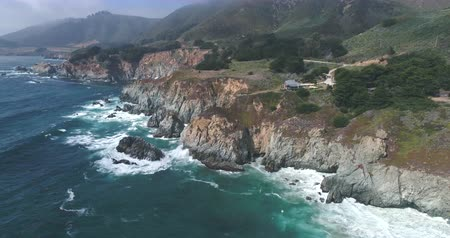 államközi : Flight over of rocky coastline. Ocean shore, waves crashing cliffs, California