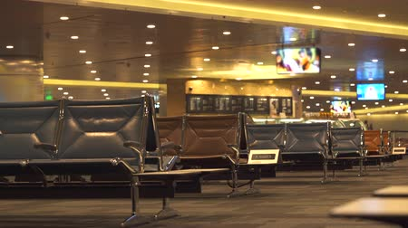 lugares sentados : Empty chairs, airport terminal waiting area - October 2017: Doha, Hamad International airport, Qatar Stock Footage