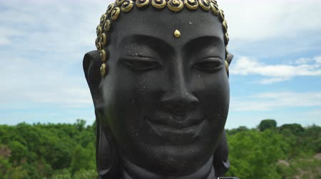 budha : Slider shot of Buddha face, Buddha head sculpture.