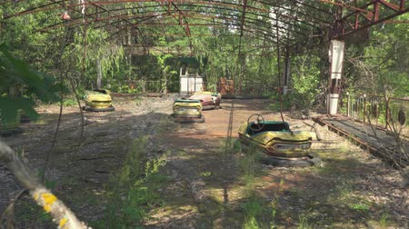evacuation : Abandoned amusement park, bumper cars in Pripyat. Chernobyl nuclear disaster. Slider shot 30km Chernobyl, exclusion zone