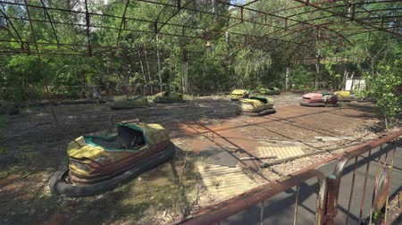 slider shot : Abandoned amusement park, bumper cars in Pripyat. Chernobyl nuclear disaster. Slider shot 30km Chernobyl, exclusion zone