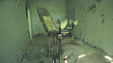 slider shot : Abandoned hospital, gynecology in Pripyat. Chernobyl nuclear disaster. Slider shot - Juni 2017: 30km Chernobyl, exclusion zone Stock Footage