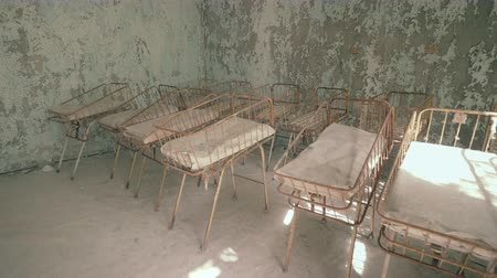 obstetrics : Neonatal ward in abandoned hospital of Pripyat. Chernobyl nuclear disaster. Slider shot 30km Chernobyl, exclusion zone Stock Footage