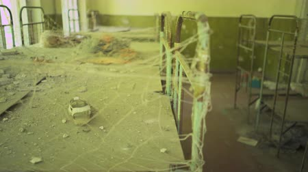 reactor : Beds in the abandoned kindergarten near Pripyat. Chernobyl nuclear disaster. Slider shot  30km Chernobyl, exclusion zone Stock Footage