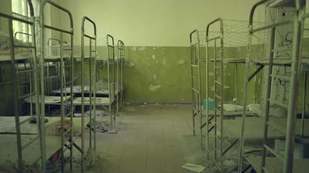 evacuation : Beds in the abandoned kindergarten near Pripyat. Chernobyl nuclear disaster. Slider shot 30km Chernobyl, exclusion zone