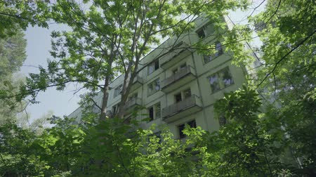 slider shot : Abandoned houses, residential in Pripyat ghost town. Chernobyl nuclear disaster. Slider shot 30km Chernobyl, exclusion zone Stock Footage