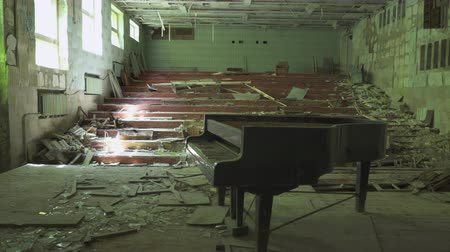 chernobyl : Abandoned concert hall with a piano in Pripyat. Chernobyl nuclear disaster. Slider shot 30km Chernobyl, exclusion zone