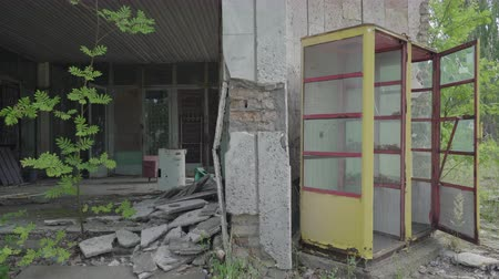 extinto : Abandoned building and call box in Pripyat. Chernobyl nuclear disaster. Slider shot 30km Chernobyl, exclusion zone Stock Footage