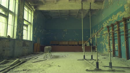 reactor : Abandoned gym hall in the school near to  Pripyat. Chernobyl nuclear disaster. Slider shot - Juni 2017: 30km Chernobyl, exclusion zone