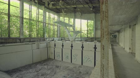 pripyat : Abandoned swimming pool building in Pripyat. Chernobyl nuclear disaster. Slider shot 30km Chernobyl, exclusion zone