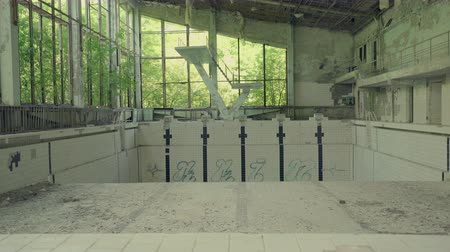 pripyat : Abandoned swimming pool building in Pripyat. Chernobyl nuclear disaster. Slider shot - Juni 2017: 30km Chernobyl, exclusion zone Stock Footage